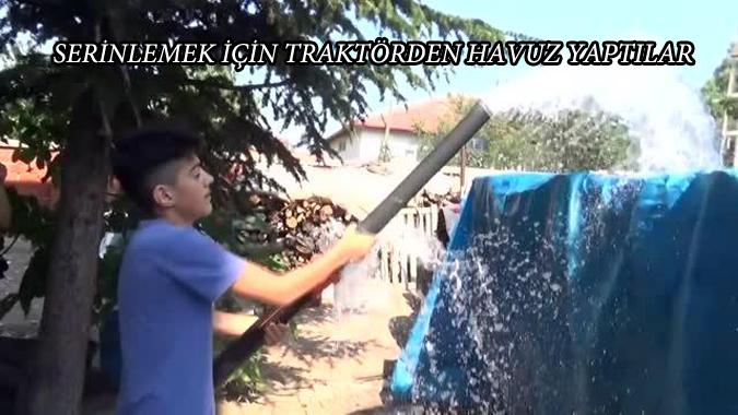 Köy çocukları traktör römorkunu havuza çevirdi